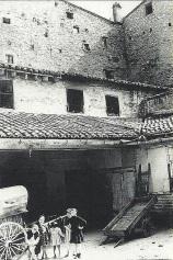 1930 Hostal del Angel with Moorish wall behind