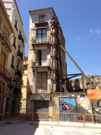 Plaza del Angel 2013. Only original building of the old Hostal del Angel. Torre now leans back against this part of the hostal. Moorish wall can just be seen.